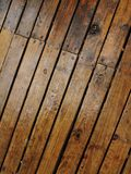 Wet wood planks - 2. Deck flooring made of wood planks, wet after the rain and shown diagonally stock image