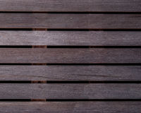 The wet  wood  ribbed planks of the batten platform. Four kinds Stock Photos