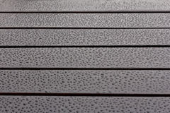 Wet wood water drops reflections Stock Photography