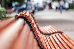 Wet wooden bench... Royalty Free Stock Image