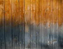 Wet wooden fence texture. Wet and discolored wooden fence texture useful for backgrounds and framing text stock images