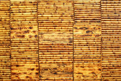 Wet yellow brown bamboo wooden wall background Royalty Free Stock Photography