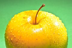 Wet yellow delicious apple Stock Images