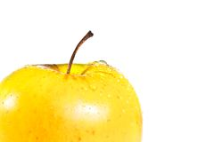 Wet yellow half apple with space for text Stock Images