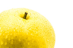 Wet yellow pear macro Stock Images