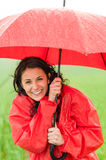 Wet young girl enjoying rainfall with umbrella Royalty Free Stock Image
