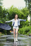 Wet young girl in the rain. Portrait of a wet young girl walking in the rain Stock Photography