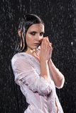 Wet young woman in aqua studio under the water drops. stock photo