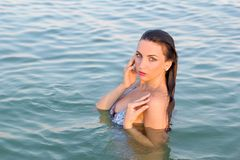 Wet young woman in the water. Portrait of a wet young woman in the water Stock Photo
