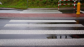 Wet zebra crossing Royalty Free Stock Images