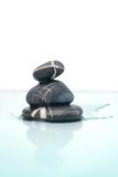 .wet zen stones. Isolated zen stones with reflection royalty free stock photos
