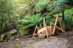 A sculpture of a giant weta in native forest, New Zealand royalty free stock image