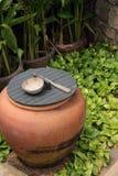 Weter jar  in garden Stock Photography