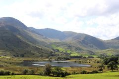 Wetherlam, Swirl How and Little Langdale Tarn. View of the Tilberthwite High Fells, Wetherlam and Swirl How seen across Little Langdale Tarn and Greenburn valley Stock Photo
