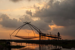 Fisherman in the lake of Thailand Royalty Free Stock Photography