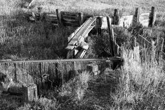 Wetland Water Control Wall. A black and white (monotone) image of wetlands water control and irrigation structure in a native habitat located in the western USA Royalty Free Stock Photos