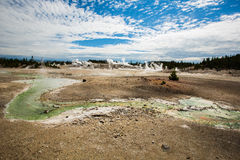 Wetlands with geothermal in yellowstone park. Wetlands with eruption of the geothermal under blue sky in yellowstone park stock photos
