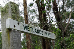 Wetlands sign in a woodland setting Royalty Free Stock Photos
