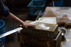 Wetstone Knife Blade Sharpening at Tsukiji Fish Market. Royalty Free Stock Images