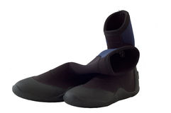 Wetsuit boots. An old used pair of surfing or diving wetsuit boots royalty free stock image