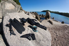 Wetsuit and a gun for underwater hunting Stock Image