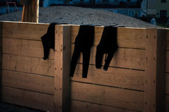 Wetsuits drying Stock Images