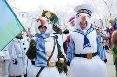 Wettbewerb des neuen Jahres von Schneemännern. Stockbilder