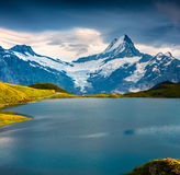 Wetterhorn and peak over Bachsee lake Stock Image
