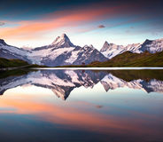Wetterhorn and peak reflected in water surface of Bachsee lake. Stock Images