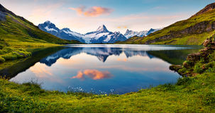 Wetterhorn and Wellhorn peaks reflected in water surface of Bach Royalty Free Stock Photography