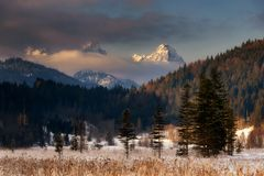 Wetterstein mountain view during winter morning. Bavarian Alps,. Wetterstein mountain view during winter morning. Cloudy sky and frozen forest near beautiful stock photography