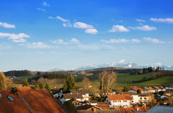 Weyarn village and view to snowy alps, germany. View over weyarn village and the bavarian snowy alps Stock Image