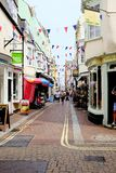 St. Alban street, Weymouth, Dorset, UK. Weymouth, Dorset, UK. May 18, 2018. Holidaymaker browse the shops on the narrow lower St. Alban steet in the town of Stock Photos