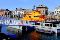 Weymouth lifeboat, Dorset, UK. Weymouth, Dorset, UK. May 14, 2018. The Wemouth lifeboat moored on a floating pontoon next to the lifeboat station with a royalty free stock photos