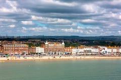 Weymouth sandy beach with Georgian architecture panorama. Weymouth in Dorset, UK, sandy beach with Georgian architecture panorama view in sunny Summer day. Full Stock Image