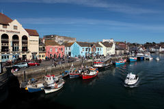 Weymouth harbour on a bright sunny summer day. The Rendezvous bar in Weymouth with boats and people outside on a warm summer day Stock Images