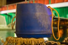 Weymouth, Jurassic Coast, Dorset, UK. A bucket in the evening light of Weymouth harbour, Jurassic Coast, Dorset, UK Stock Image