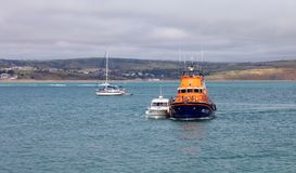 Weymouth lifeboat rescuing stricken boat. Royalty Free Stock Photos
