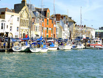 Weymouth quayside, Dorset. Yachts and boats moored at the quayside at Weymouth, Dorset, England, UK Stock Photos
