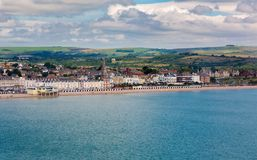 Weymouth sandy beach with Georgian architecture panorama. Weymouth in Dorset, UK, sandy beach with Georgian architecture panorama view in sunny Summer day. Full Royalty Free Stock Images