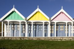 A row of beach huts in sunlight along the Esplanade promenade, Weymouth, Dorset,. WEYMOUTH, UNITED KINGDOM - DECEMBER 26, 2017 - A row of beach huts in sunlight stock image