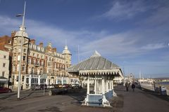 Victorian shelter along the Esplanade promenade with the Royal Hotel, Weymouth,. WEYMOUTH, UNITED KINGDOM - DECEMBER 26, 2017 - Victorian shelter along the royalty free stock images