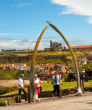 Whale bone arch. At Whitby in East Yorkshire with view of church and abbey framed by the bones, blue sky background royalty free stock photo