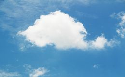 Whale cloud. A big cloud looked like a whale swimming in the blue sky Stock Images