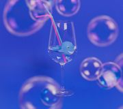 Whale in glass with water and plastic straws. Environmental concept. royalty free stock photography