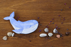 Whale made of clay on a wooden background Stock Images