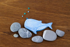 Whale made of clay on a wooden background Royalty Free Stock Photo