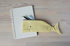 Whale pencil case, notes and pens stock photos
