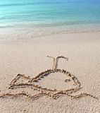 The whale - a picture on sand.Close up in a sunny day Stock Images