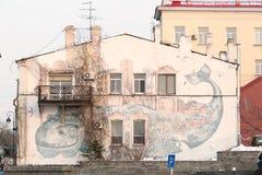 Whale on a wall. Vladivostok, Primorsky Region, Russia - January 4-th, 2015: Vladivostok, Svetlanskaya street, 4, the sea whale represented on a house wall Royalty Free Stock Image